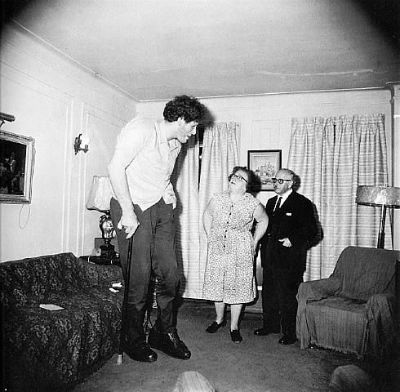 Jewish giant at home with his parents in the Bronx, NY